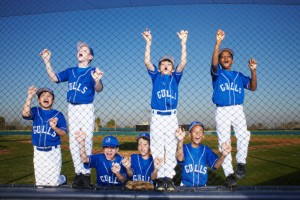 Baseball Team Climbing Fence
